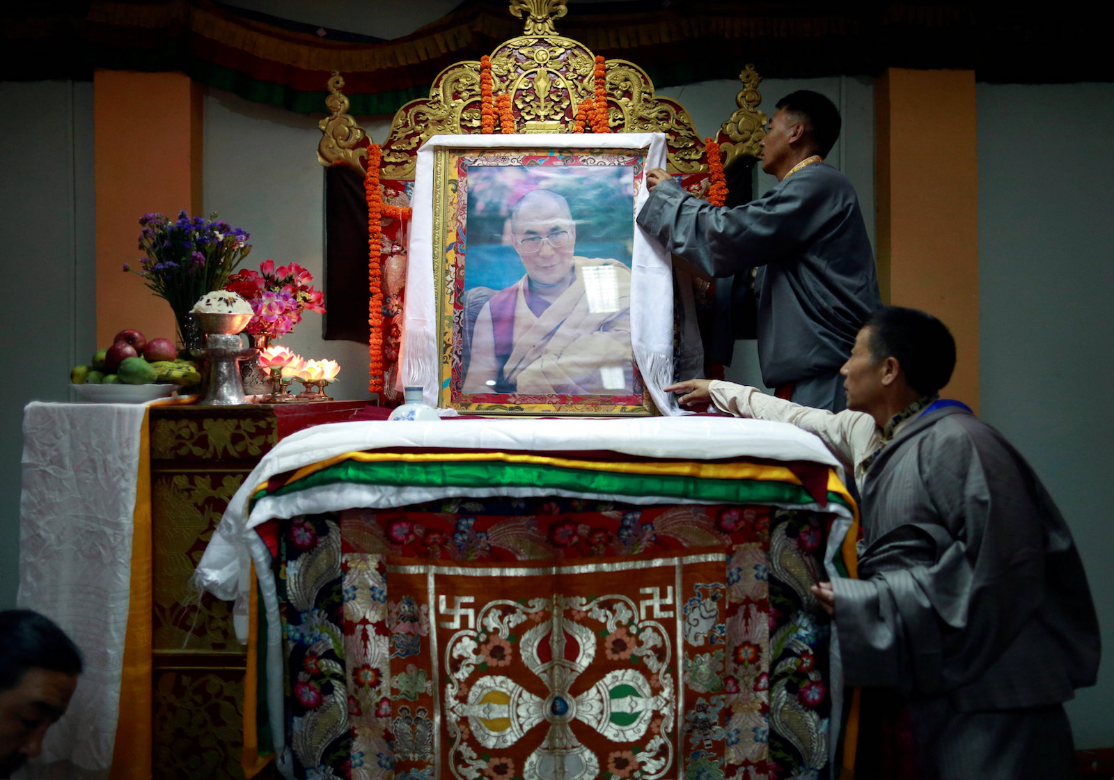 Tibetans arrange the portrait of Dalai Lama during a function organised to mark the 82nd birthday celebration of Dalai Lama in Lalitpur, Nepal July 6, 2017. REUTERS/Navesh Chitrakar