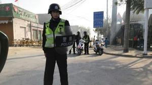 Polizia cinese in Xinjiang